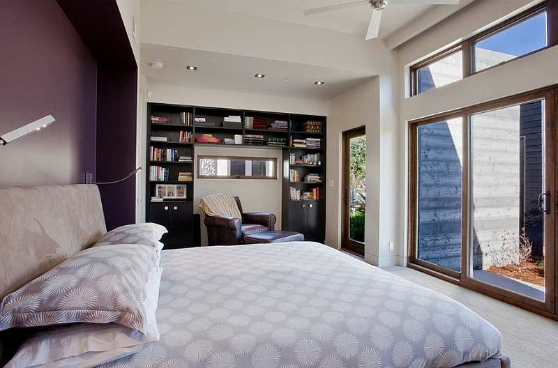 Eggplant accent wall enlivens the bedroom in neutral hue