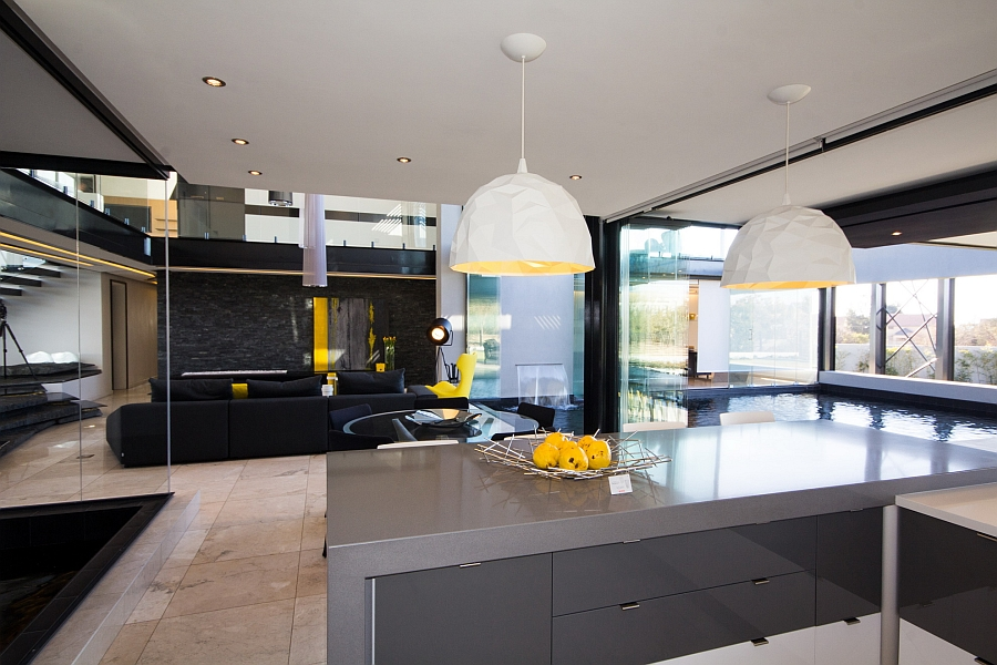 Elegant ROCK pendant lights above the kitchen island