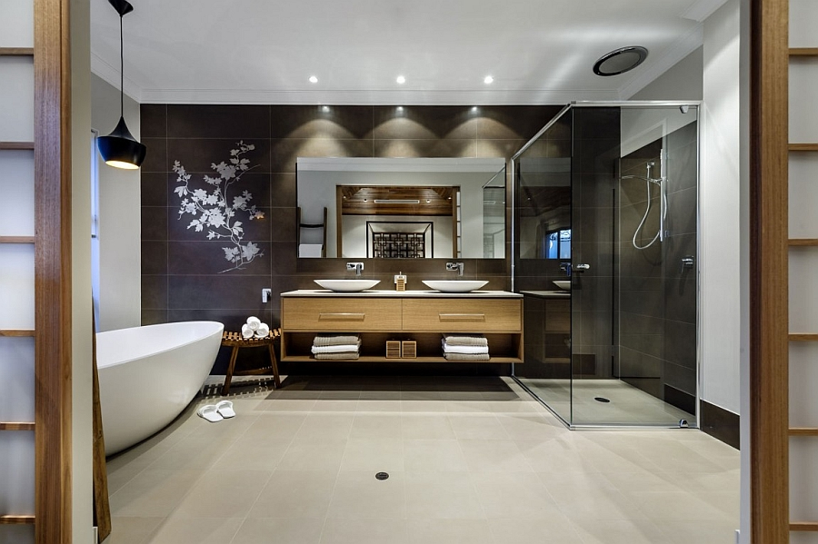 Elegant and amazing bath with a dark backdrop and a standalone bathtub in white
