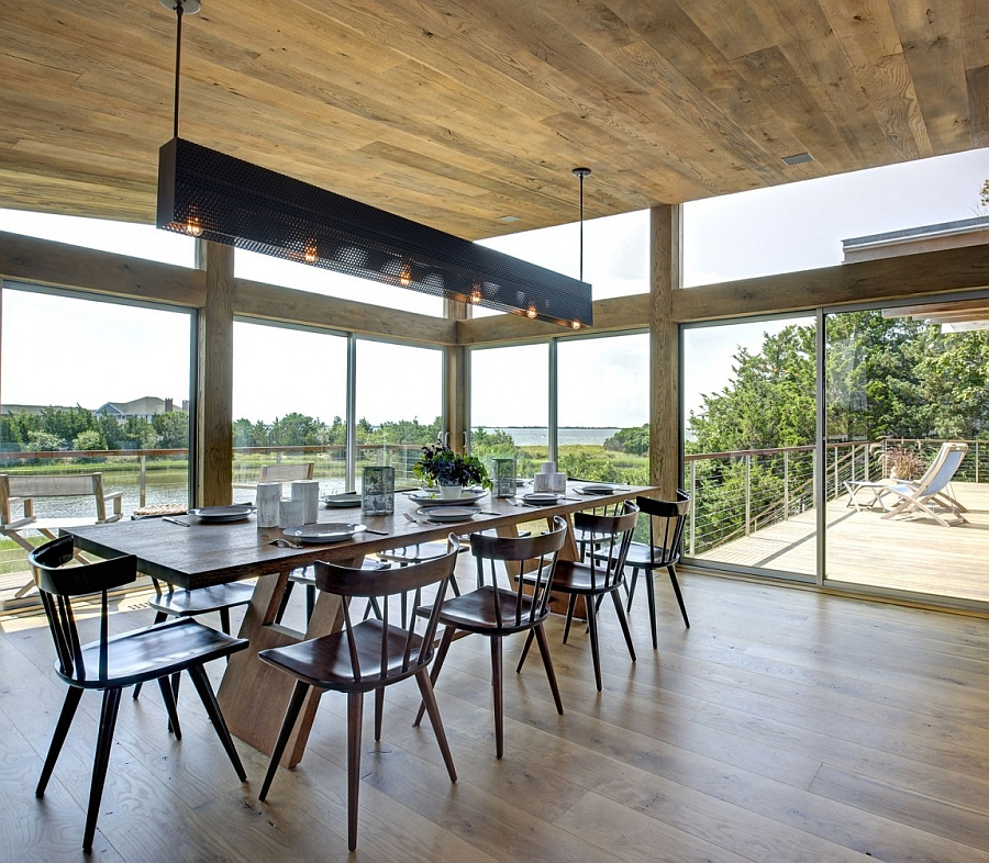 Elegant dining area with glass walls that connect it with the beautiful outdoors