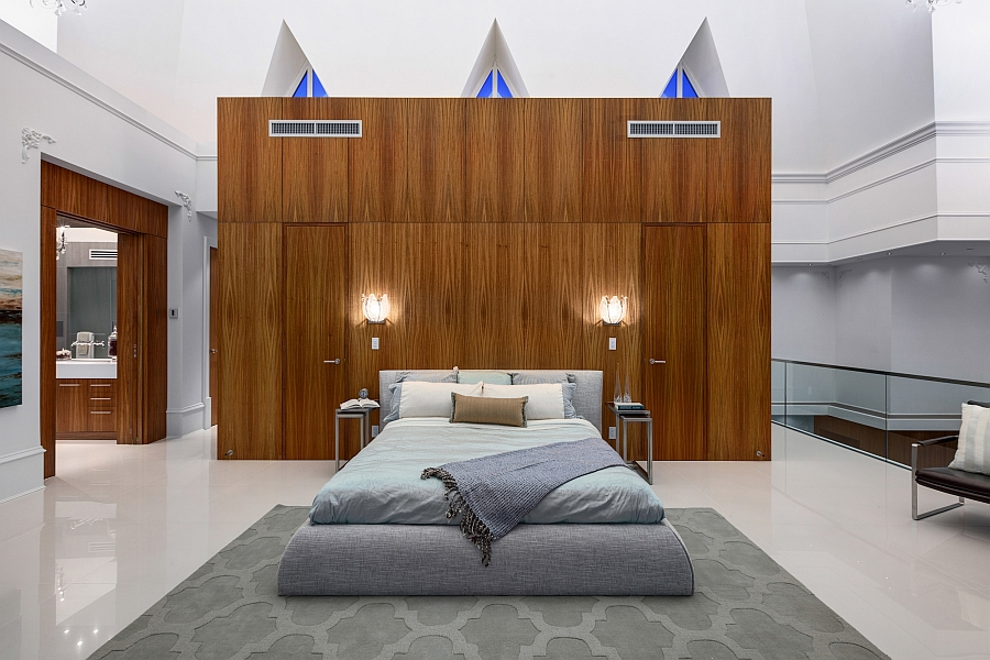 Elegant master bedroom of the penthouse with a wooden accent addition