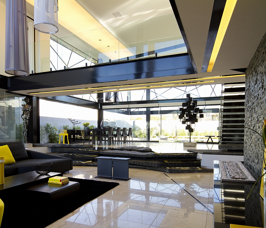Expansive living space of House BER with a double height ceiling