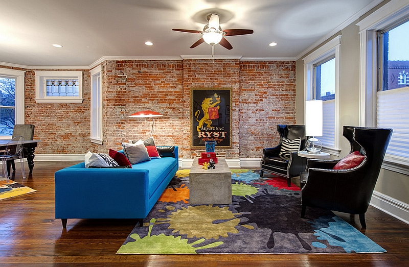 Exposed brick walls bring a touch of historic charm to the living room
