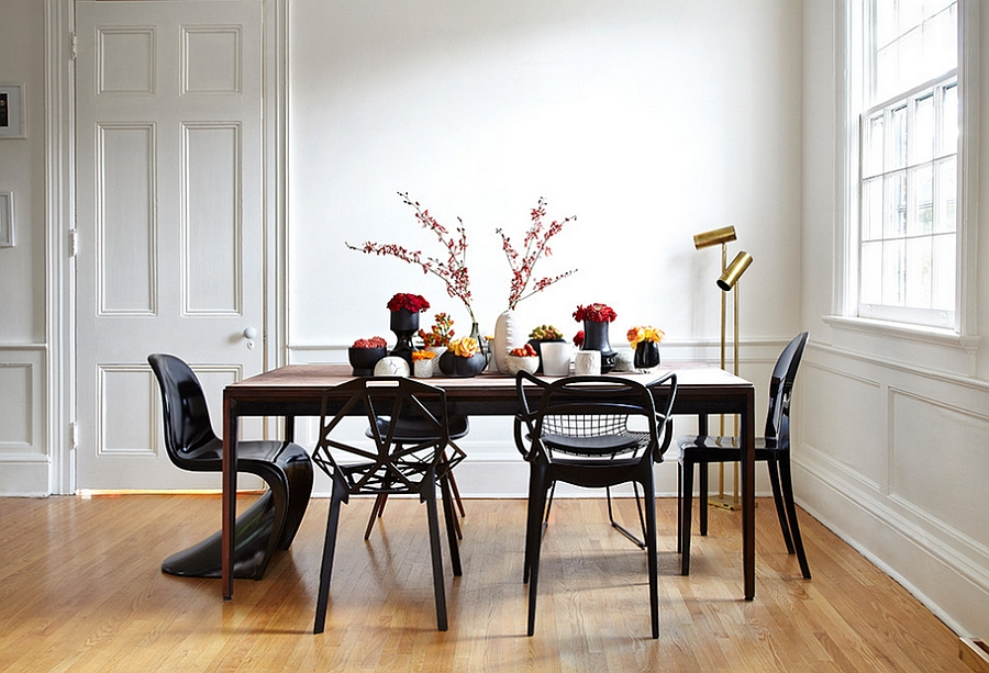 Exquisite blend of sculptural chairs at the dining table [Design by Stephane Chamard and Photography by Lisa Petrole]