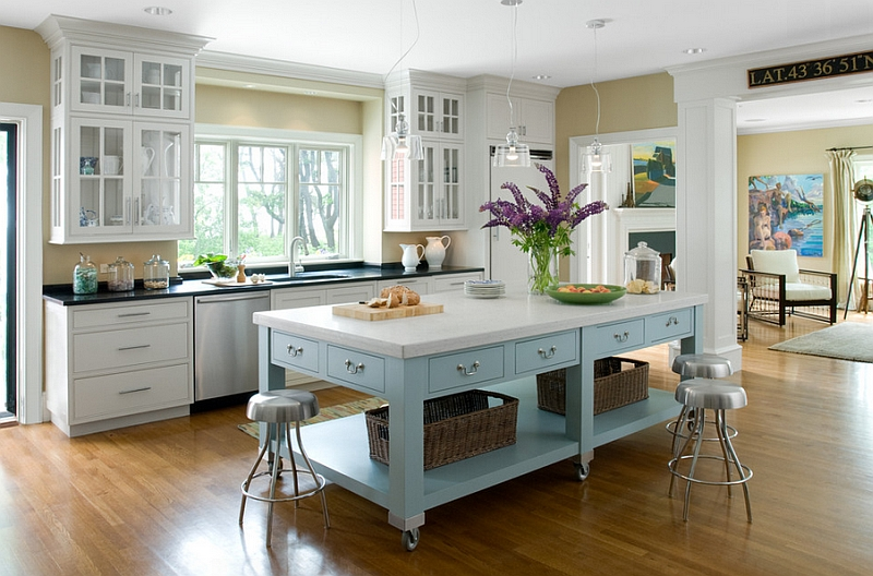 Exquisite kitchen island on casters in beautiful blue and white with ample storage