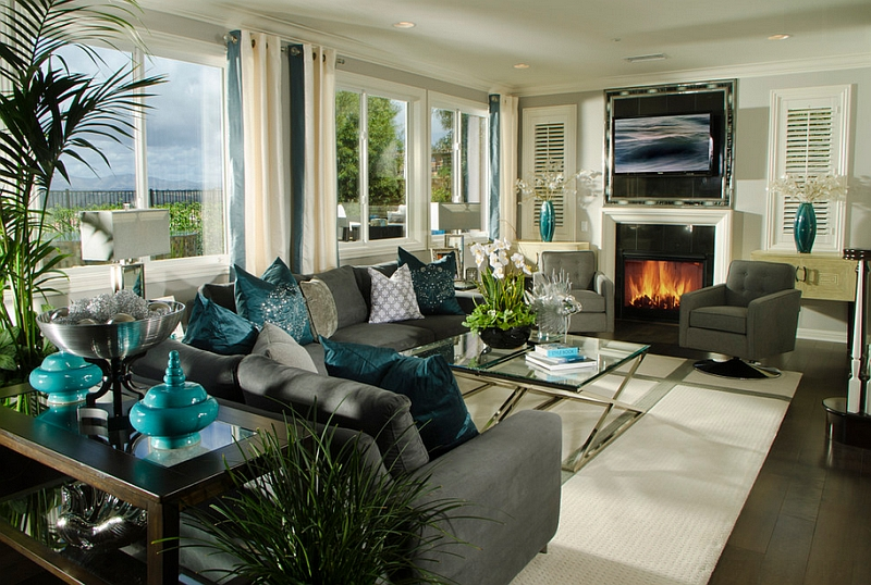 Exquisite use of teal accents throughout the stunning living room