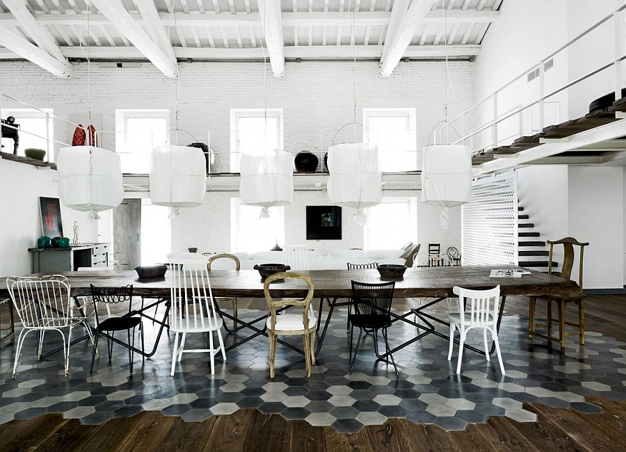 Exquisite use of tiles to demarcate the dining area in an open floor plan 200 Year Old Italian Factory Transformed Into An Enchanting Home With Industrial Charm