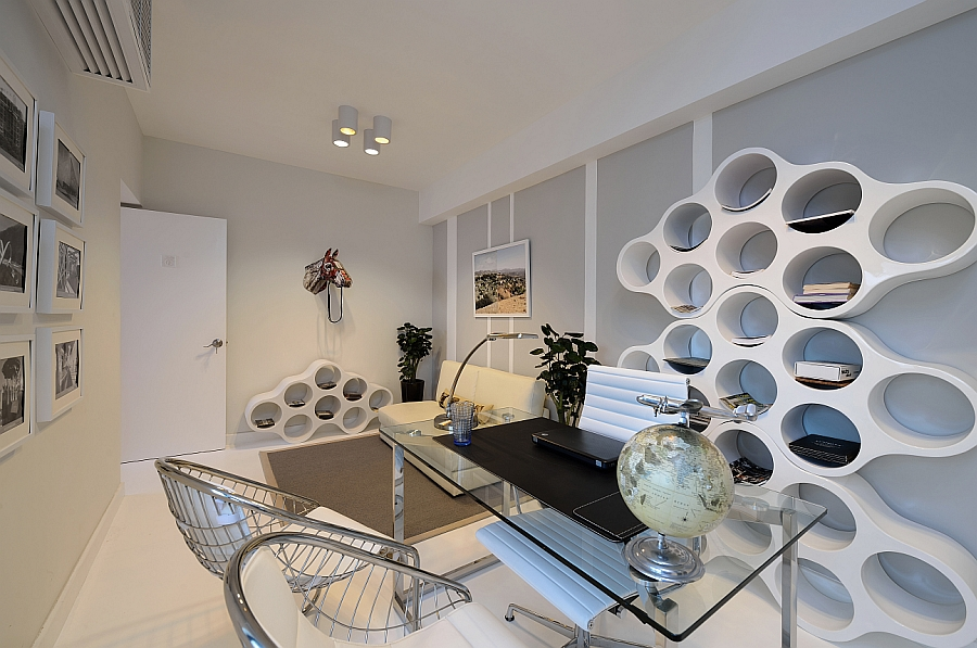 Fabulous home studio with a custom designed bookshelf that adds geometric pattern