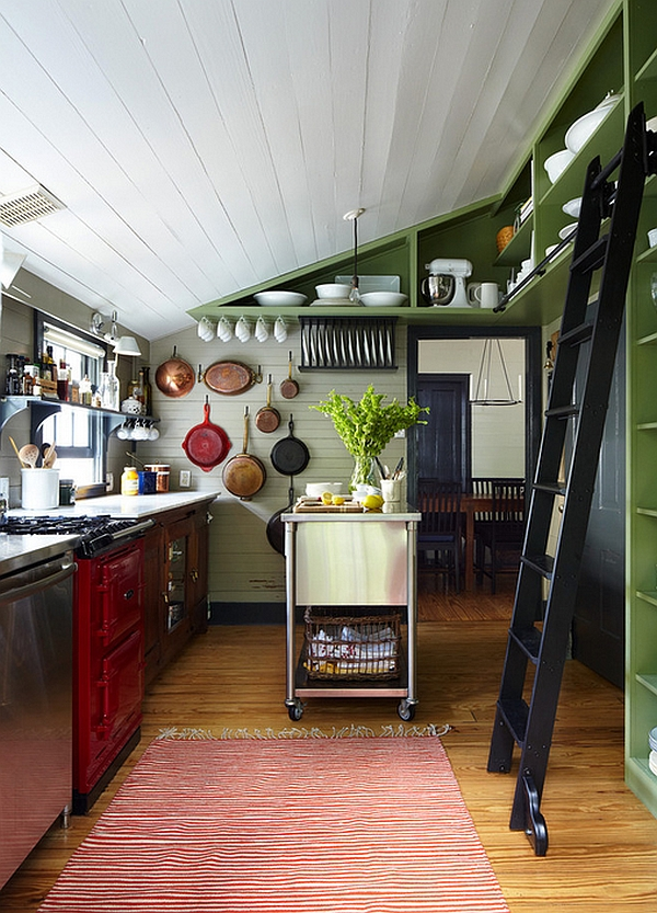 Farmhouse kitchen with sloped roof, ladder and kitchen island on wheels