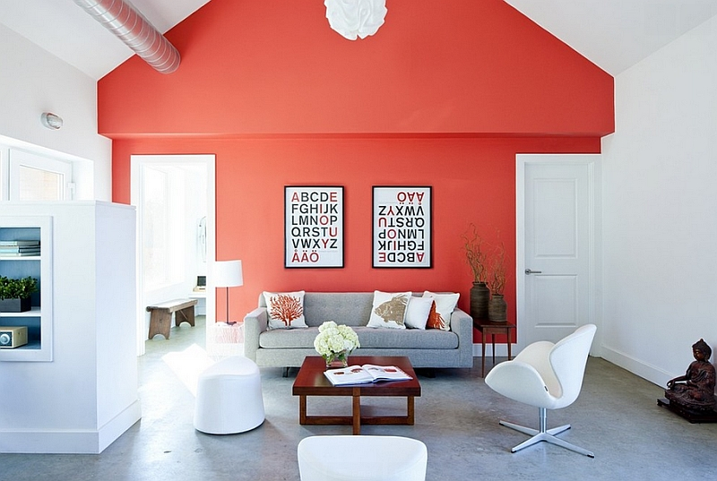 Farmhouse style living room with a bright coral accent wall and iconic decor