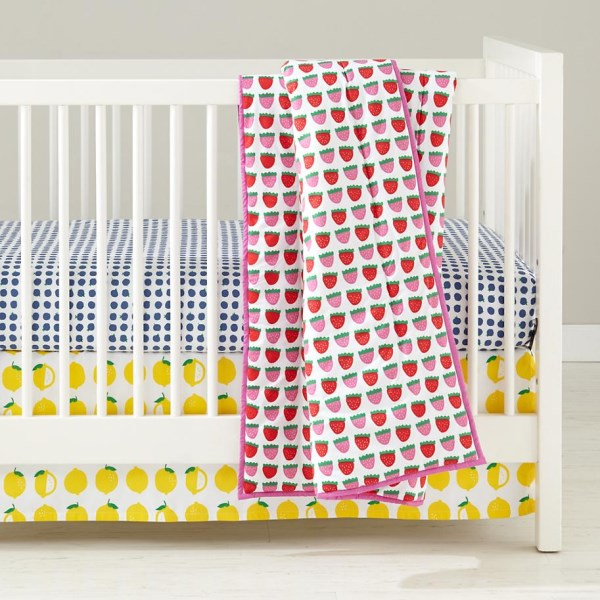 Fruit-motif baby bedding from The Land of Nod