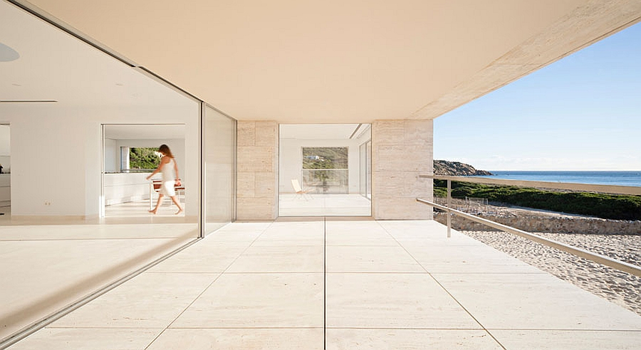 Glass doors and a neutral interior give the home a minimal appeal