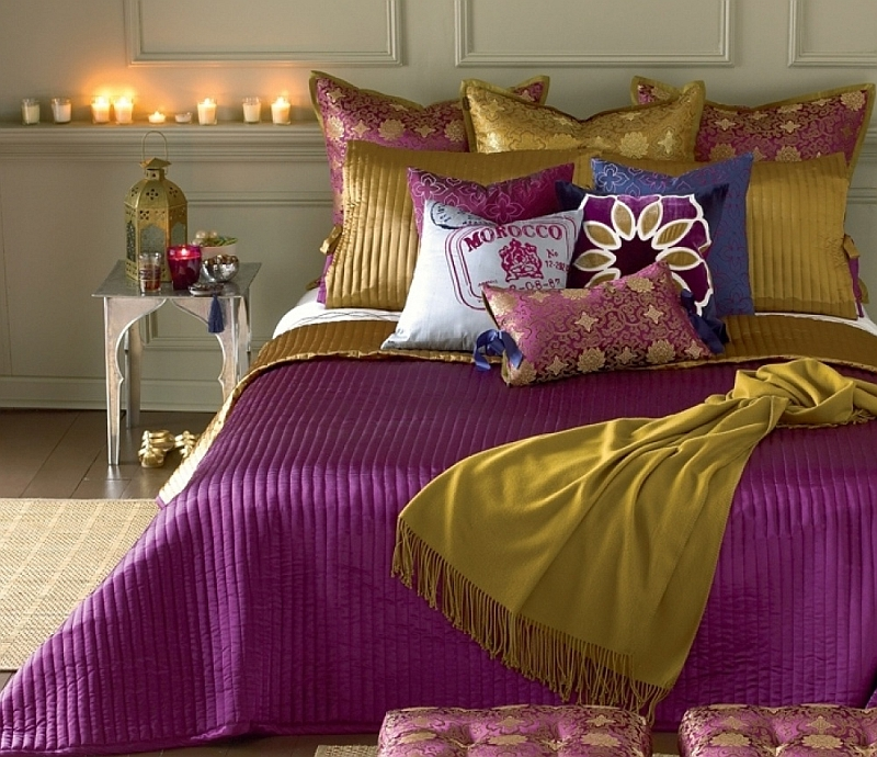 Gold and purple create a plush and sophisticated ambiance in the bedroom