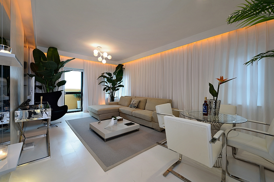 Goregous living room in white with orange LED lighting and a tropical touch