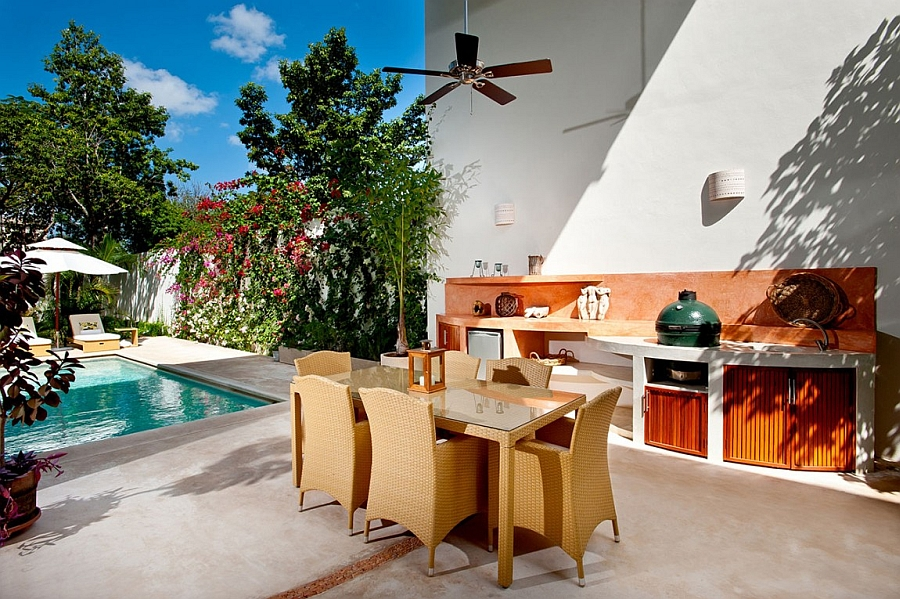Gorgeous outdoor dining area and kitchen next to the pool