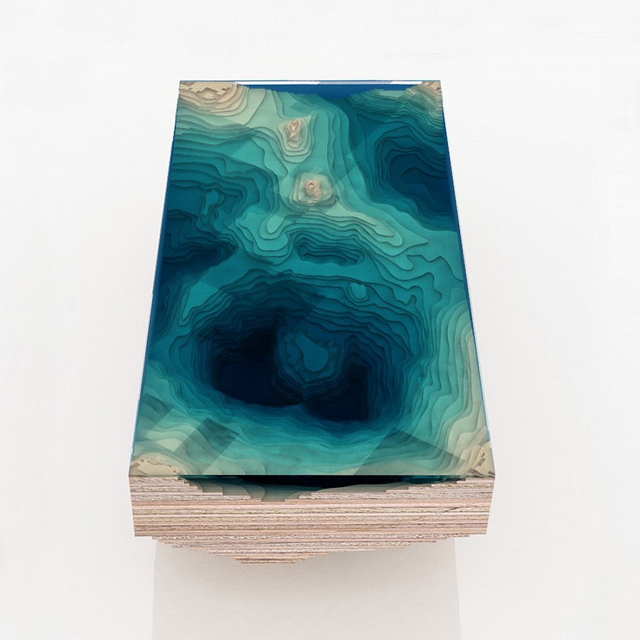Gorgeous table uses multiple layers of glass and wood to replicate the sea bed
