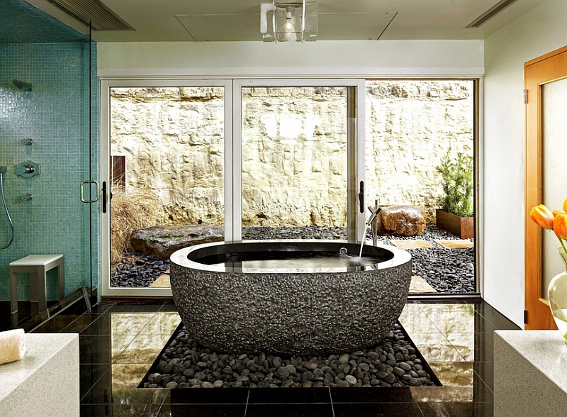Gorgeous use of natural pebbles under the standalone bathtub
