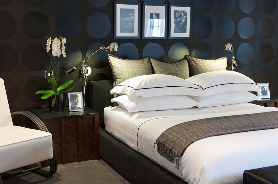 Graphic circles on the wall and the dark backdrop lend sophistication to the stylish bedroom