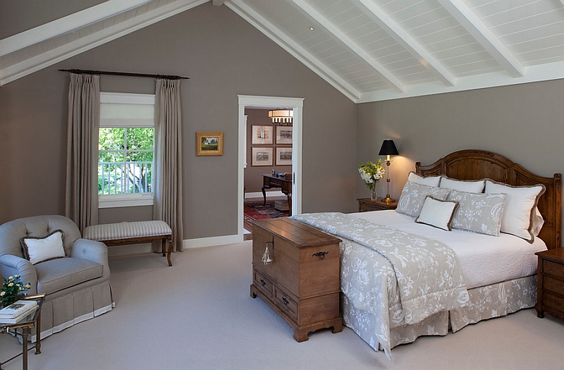 Grey walls add refinement to the room with slanted ceiling