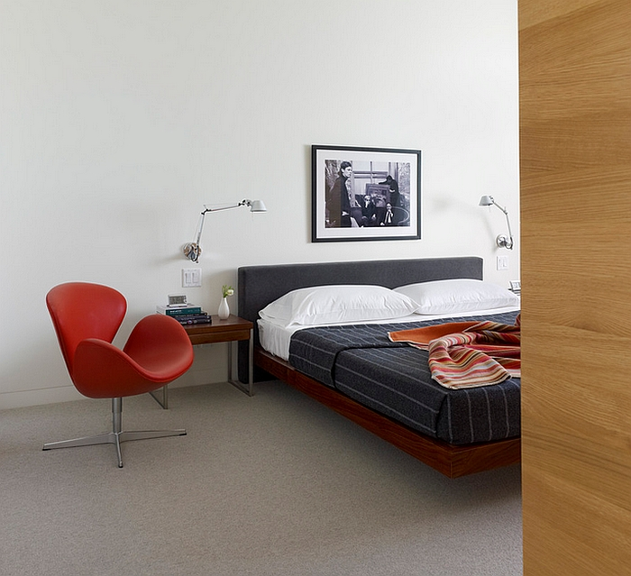 Iconic Swan Chair adds color to the largely neutral bedroom