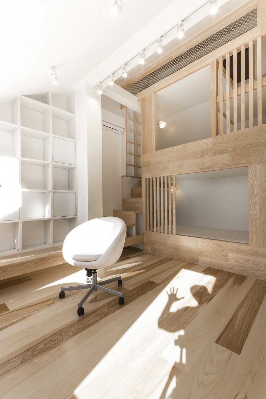 every element of the apartment including the curvy wooden staircase