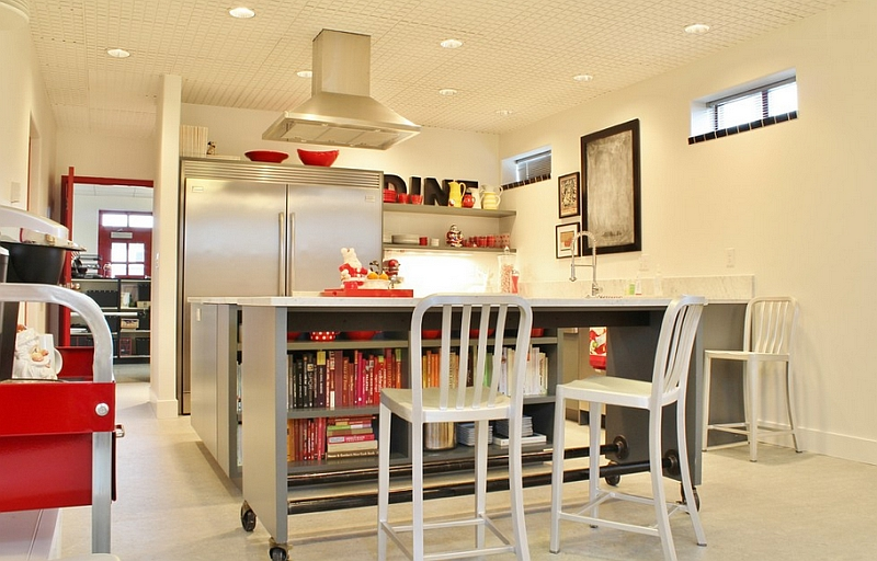 Industrial kitchen with island on casters and aluminum bar stools