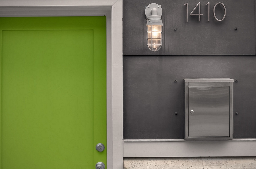 Industrial styled entrance with a gorgeous green door