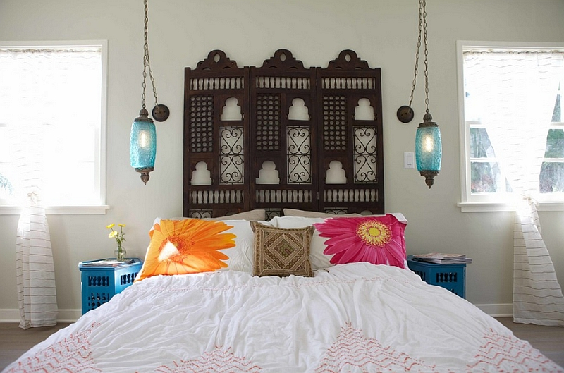 Innovative bedside lights save up on space in this Moroccan-inspired bedroom