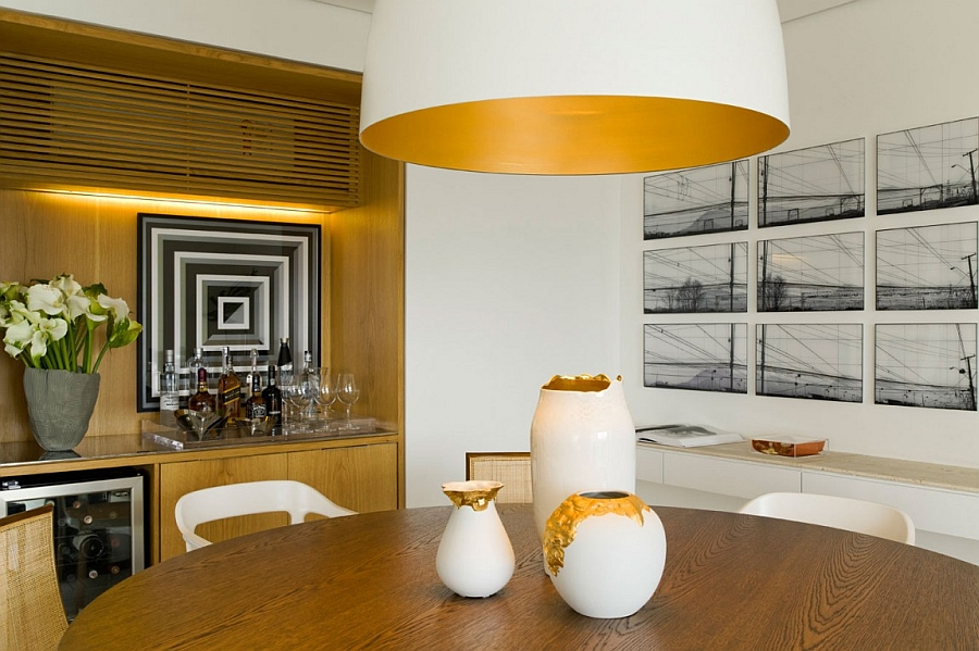 Interesting art work and accent lighting brighten the dining area