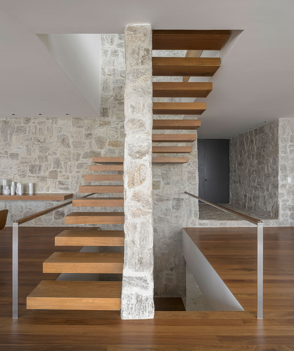 Interior in stone and wood offers a blend of contrasting textures