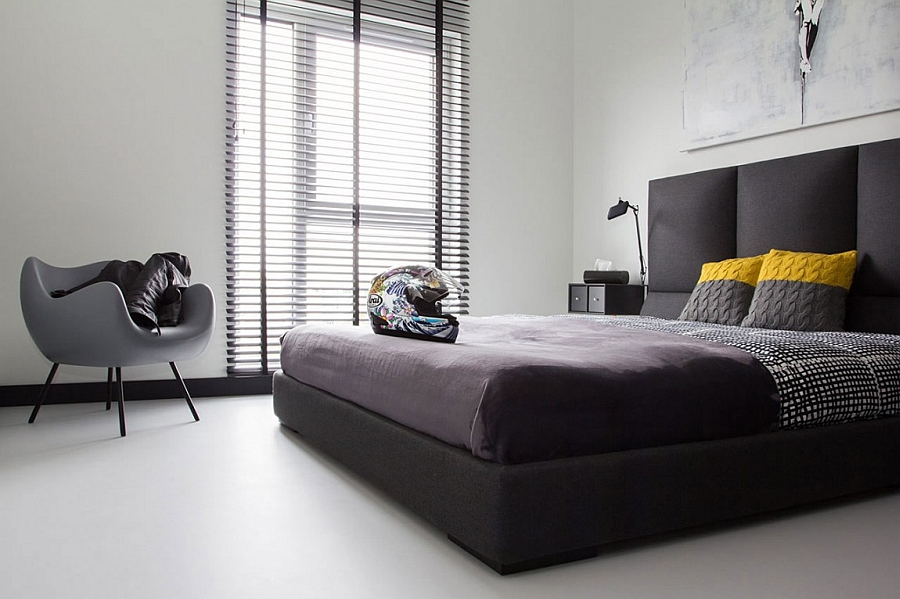 Keeping the bedding as neutral as possible in a posh black and white bedroom