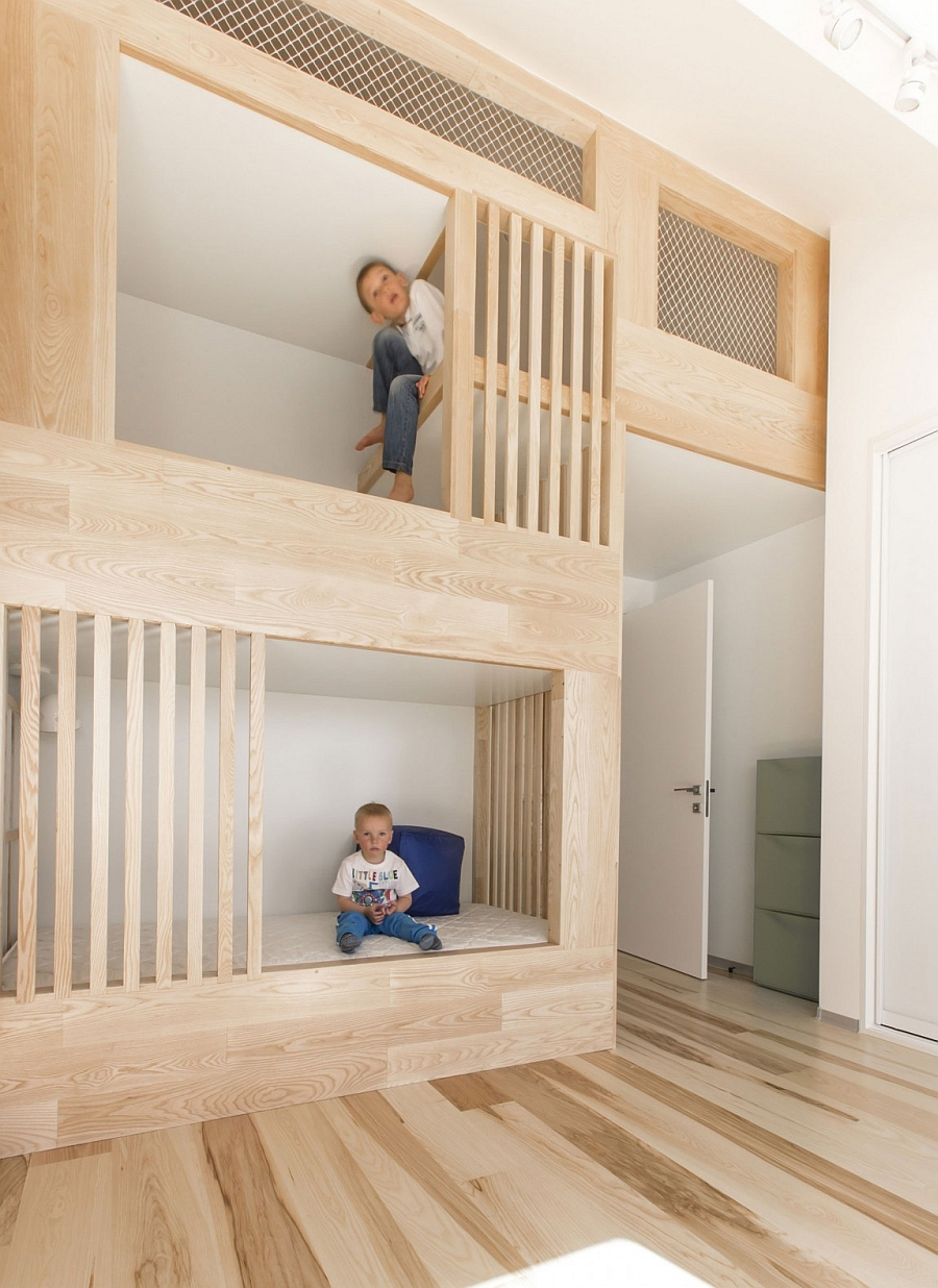Kids' bunk beds that are built into the design of the loft apartment
