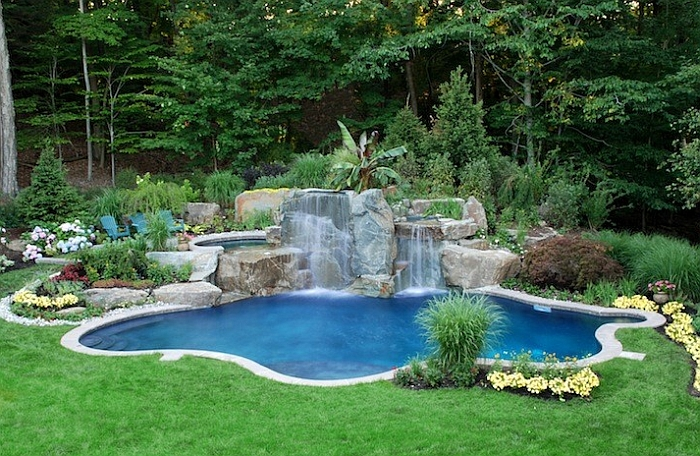 the pool and the waterfall define the aura of this gorgeous pool