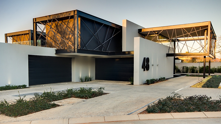 Large cantilevered boxes enclosed by black steel bars shape the South African house Expansive House Ber Amazes With An Exciting Array Of Sculptural Elements