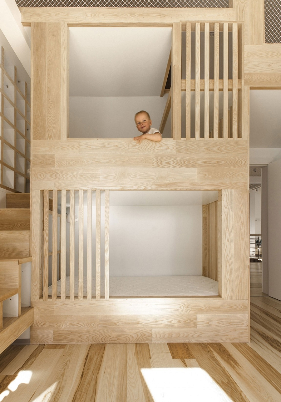 Large wooden structure with bunk beds for kids also comes with safety features