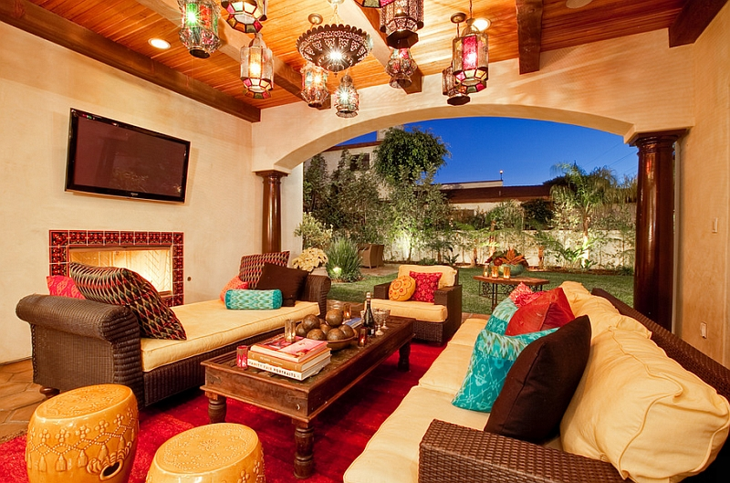 Lavish Moroccan living room that is seamlessly connected with the backyard