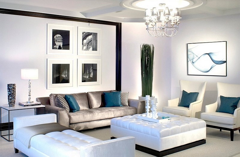 Lavish black and white living room with posh blue accents for Black white and blue living room ideas