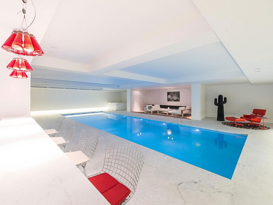 Lavish indoor pool with a home bar