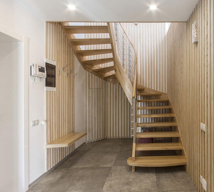 Light wood tones and sculptural staircase that saves up on space