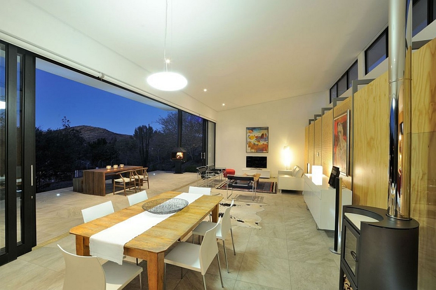 Living area opens up towards the concrete deck space thanks to the sliding glass doors