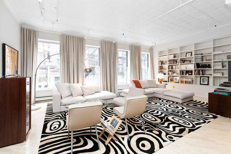Living room of Chic Soho Style apartment keeps the focus on white