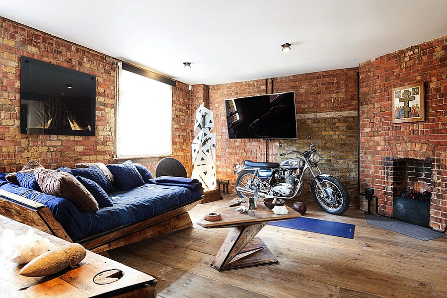 Living room of chic London apartment with exposed brick walls