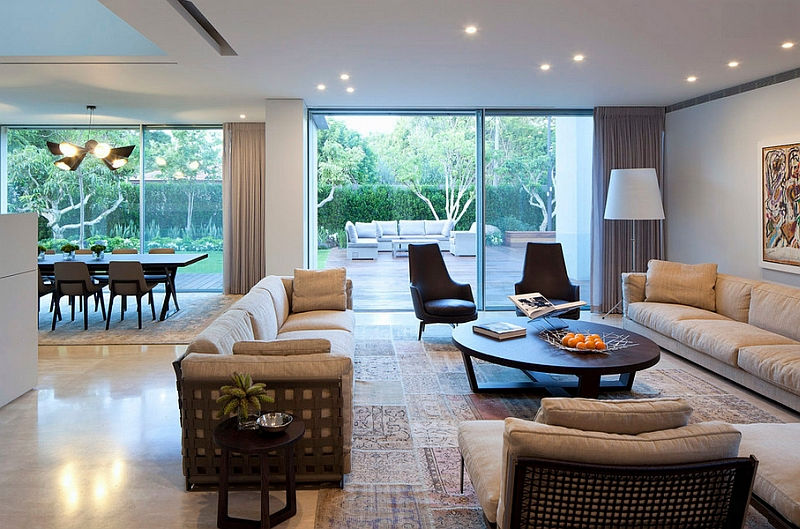 Living space with low ceiling uses windows and drapes in a smart fashion