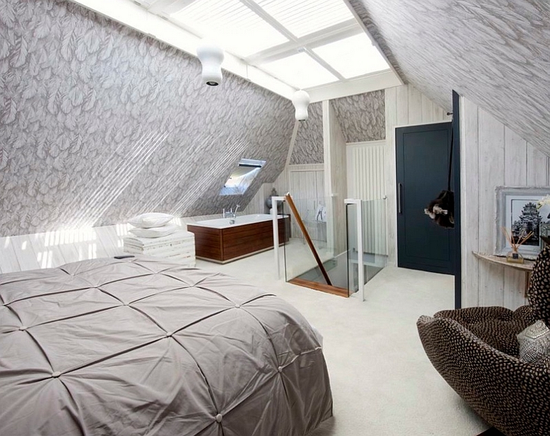 Loft bedroom with a standalone bathtub in the corner