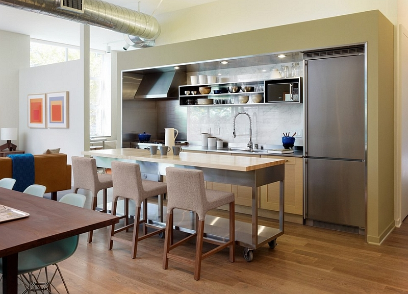 Long cart in the industrial kitchen doubles as the perfect kitchen island