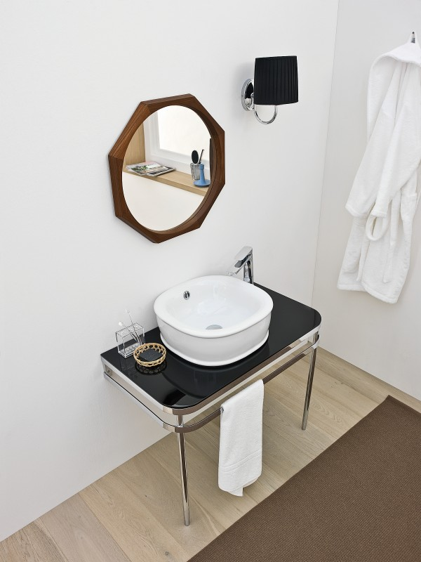 Lovely Azuley sink adds black hue to the trendy, white bathroom