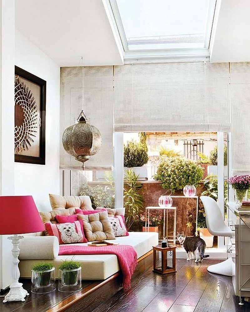 Lovely fuchsia accents breath life into the gorgeous Moroccan Living Room