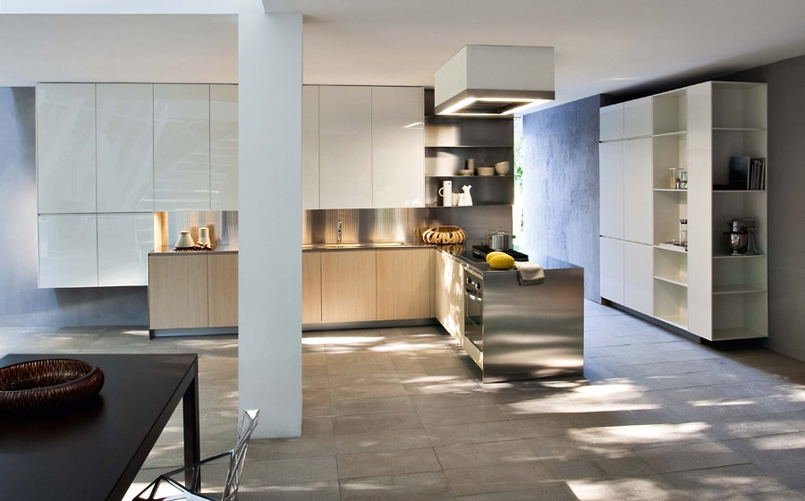 Lovely stainless steel kitchen peninisula that is connected with the ergonomic workstation