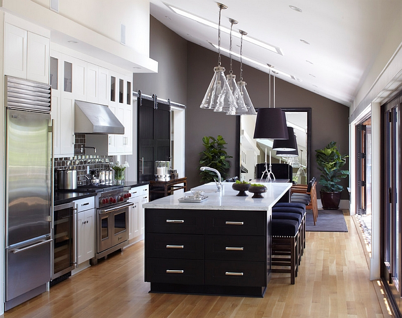 Lovely use of gray in the kitchen along with the black cabinets