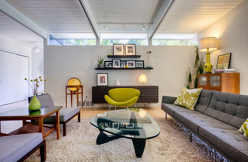 Low ceiling living room with a window at the top and iconic Mid-Century Modern decor